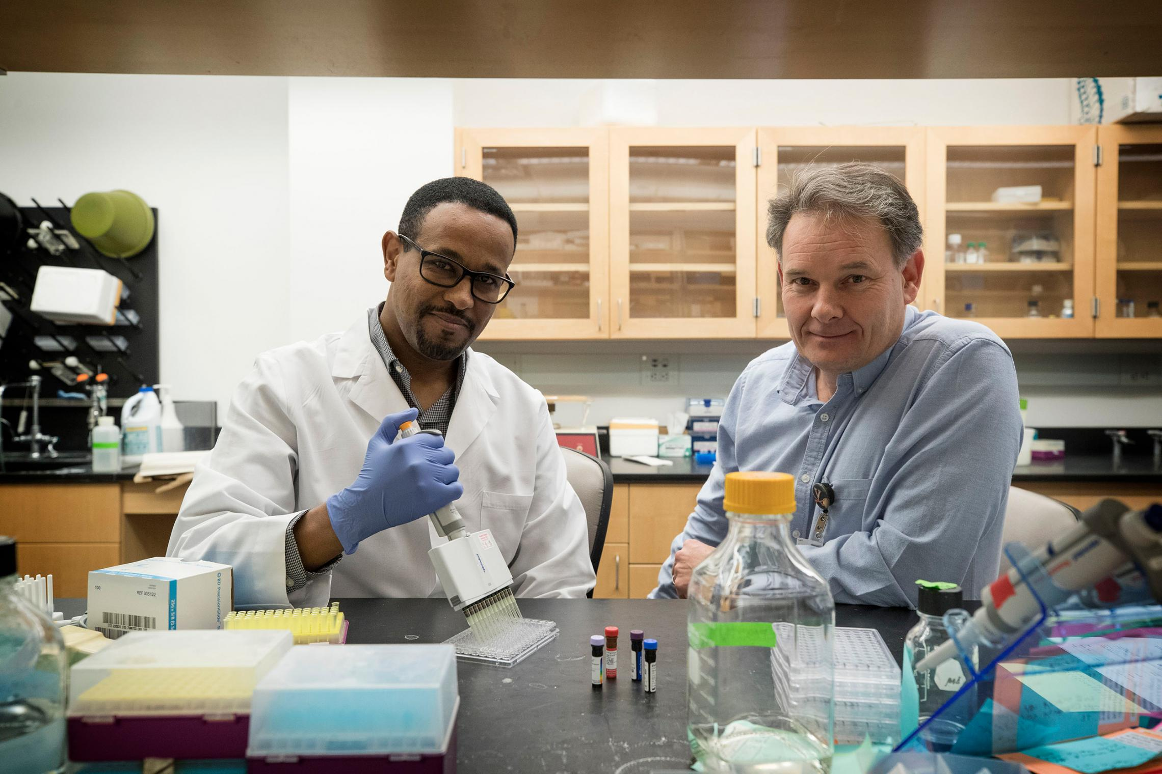 Medical researchers Lelisa Gemta, left, and Timothy Bullock discovered that a defect in some immune cells may make them less effective in combatting cancer.