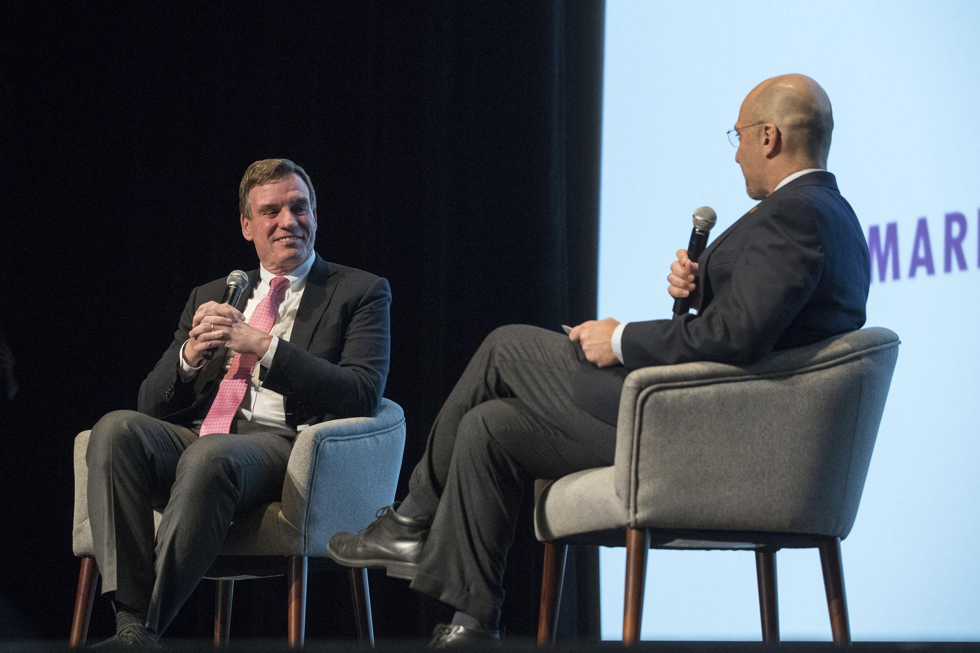 Virginia Sen. Mark Warner, left, discusses the first 100 days of the Trump presidency with Miller Center Director and CEO William Antholis.