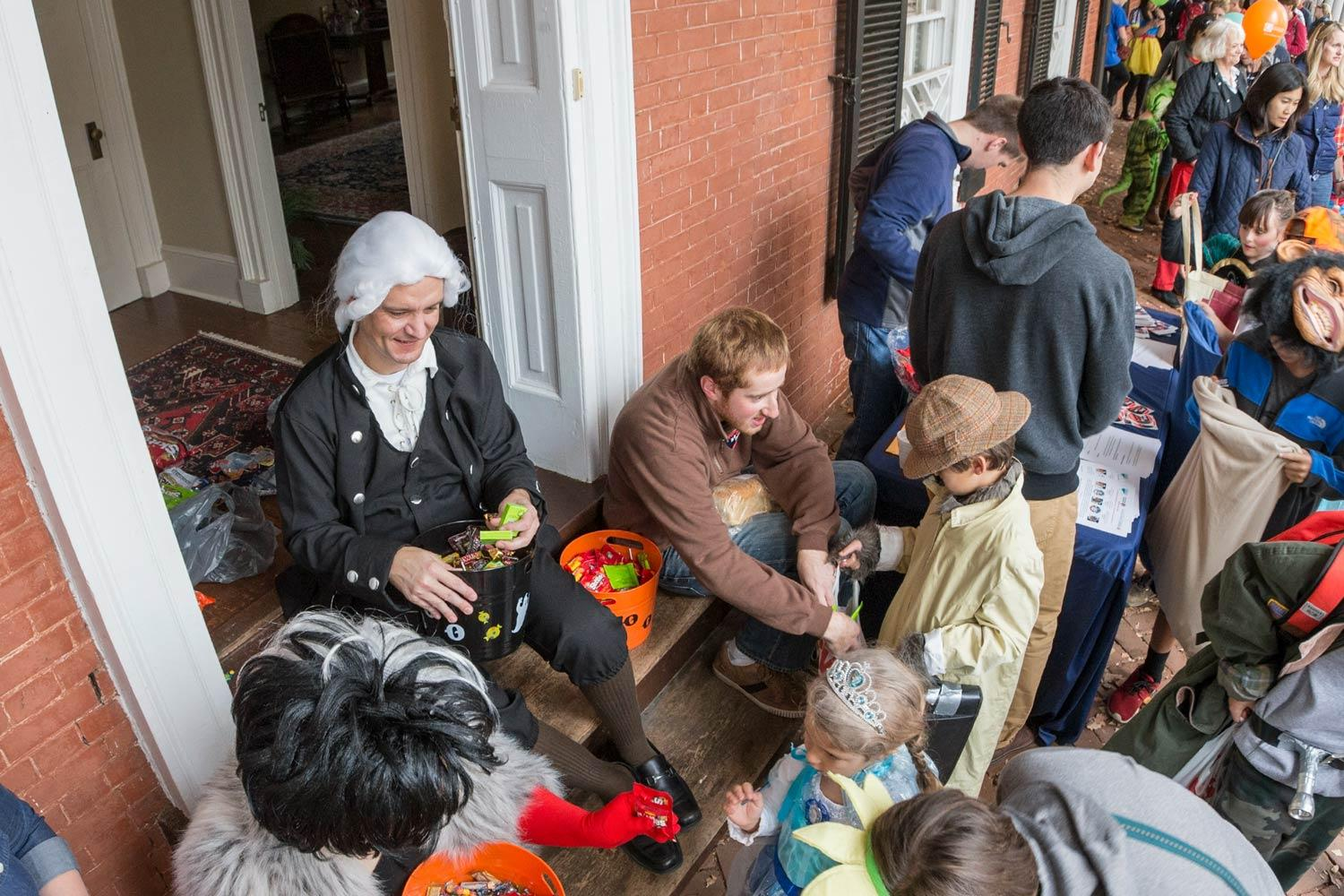 Students hand out candy to trick-or-treaters from one of UVA's ten pavilions.