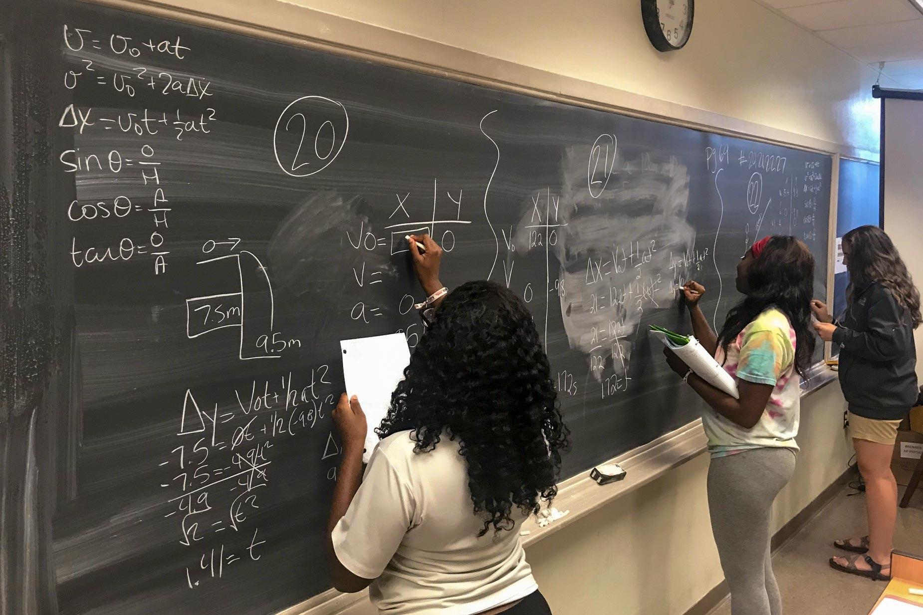 High school juniors in Mississippi work on problems in their AP physics class, which is supported by tutoring from students from the University of Virginia and other top-level colleges around the country.
