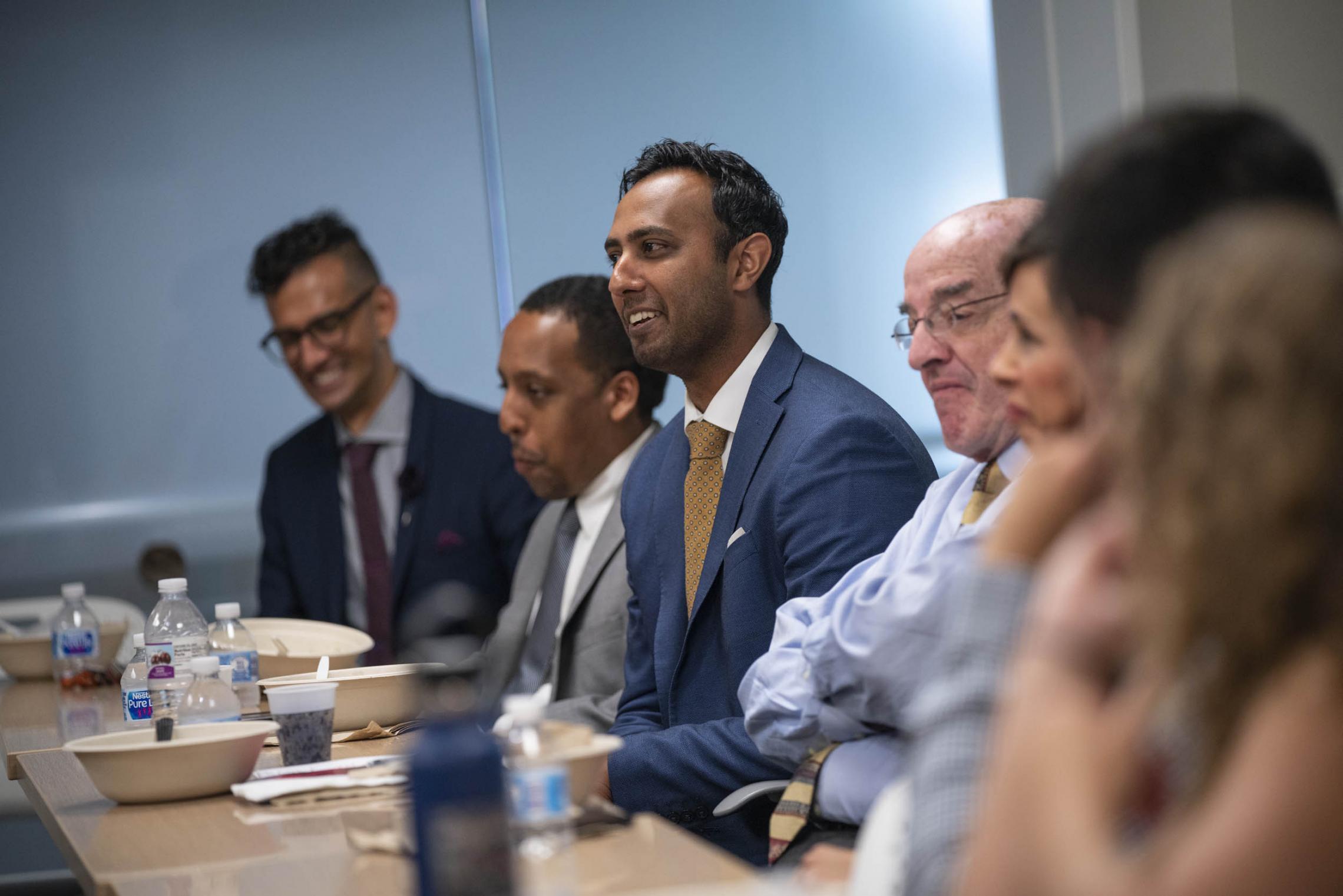 Alumnus Umair Javed, legal adviser to FCC Commissioner Jessica Rosenworcel, talked with UVA media studies students on Tuesday.