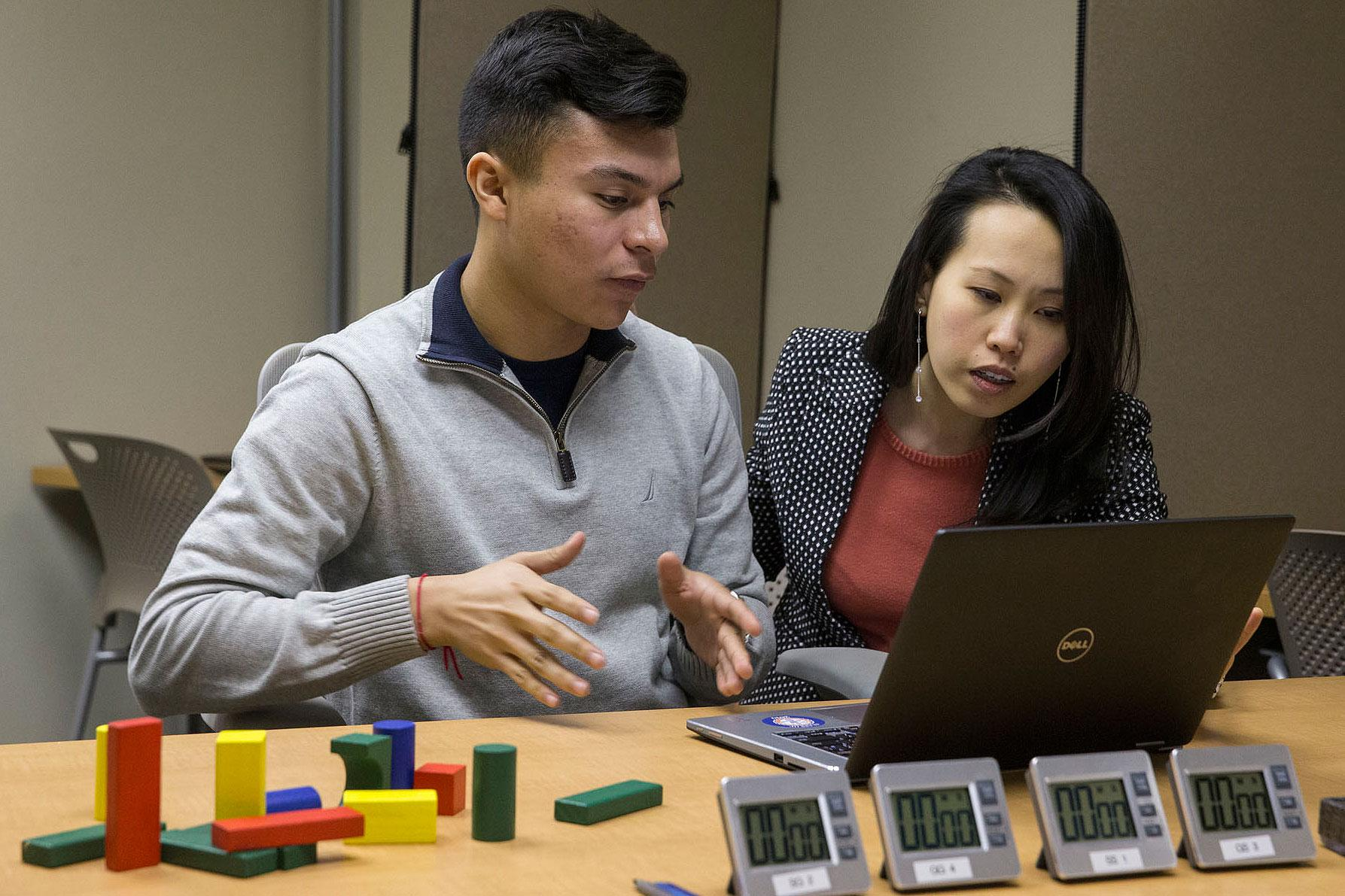 First-year College of Arts & Sciences student Hector Quijano is working with Eileen Chou, an assistant professor in the Batten School of Leadership and Public Policy, to research leadership and organizational behavior. (Photo by Dan Addison)