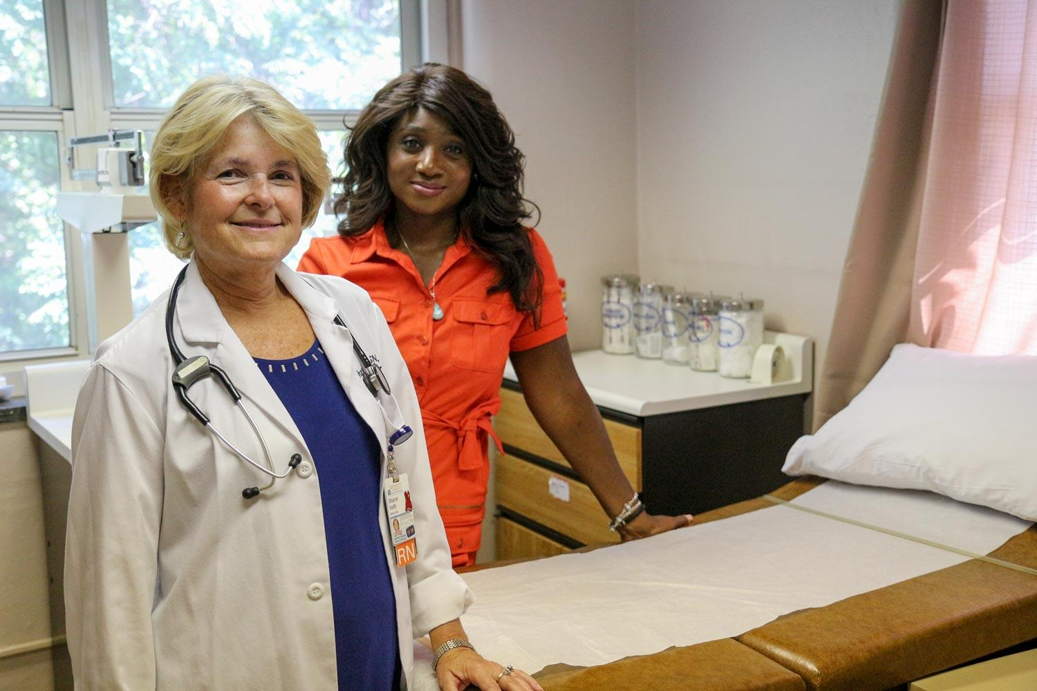 Community health nurse Sharon Veith, left, and Camille Burnett, an associate professor of nursing, at the Westhaven clinic.
