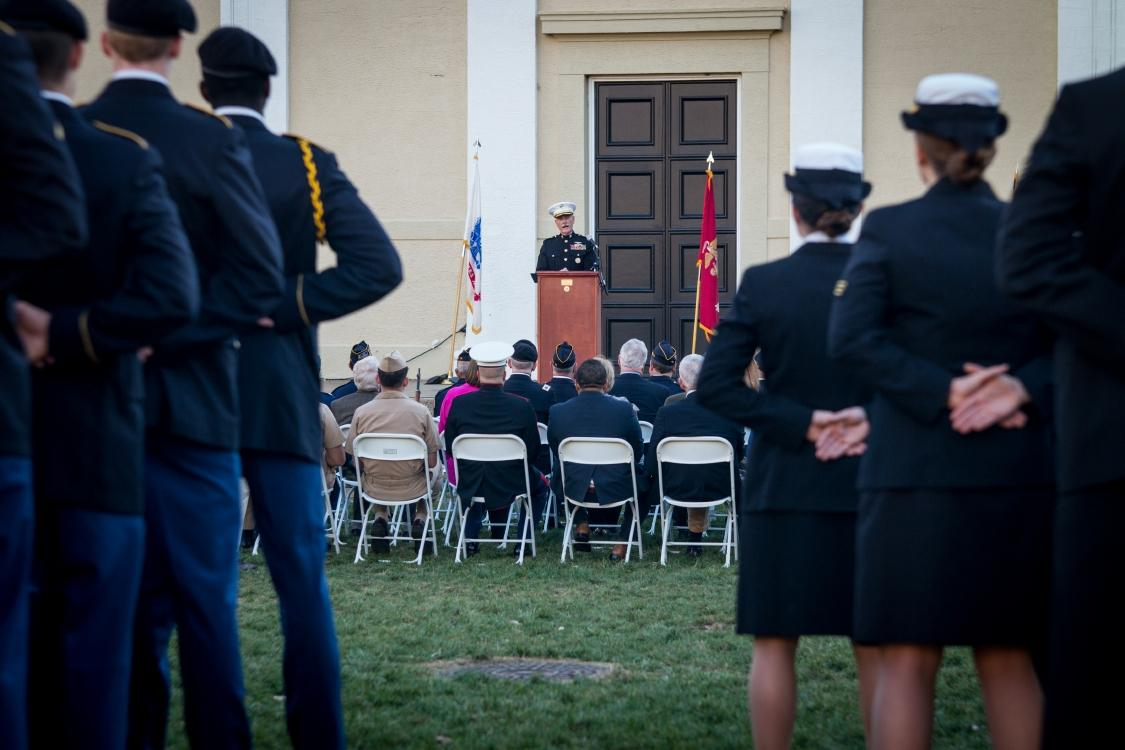 ROTC cadets listen to the keynote speaker at the 2014 vigil. This year's remembrance will be held Nov. 9-10.