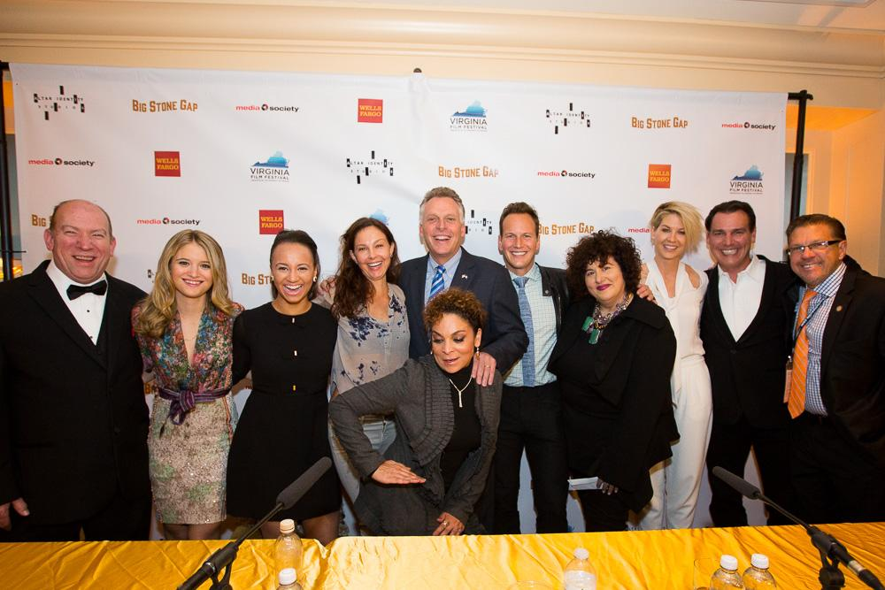 """Governor Terry McAuliffe (center) and Jody Kielbasa, director of the Virginia Film Festival (far right), with the cast of """"Big Stone Gap""""."""