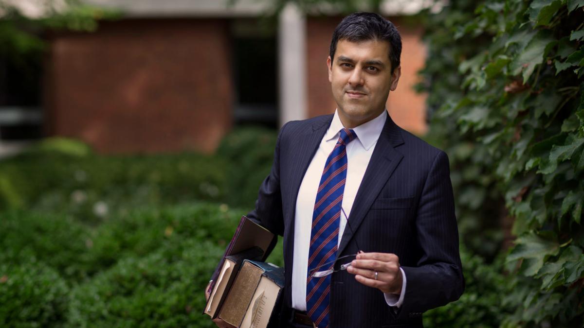 Among new School of Law professor Aditya Bamzai's academic interests is the growing field of cyberlaw. (Photo by Dan Addison/University Communications)