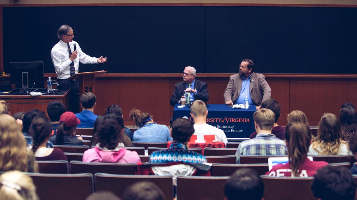 Batten Professor Gerald Warburg, left, poses questions to Congressman Gerry Connolly, center, and Congressman Tom Garrett.