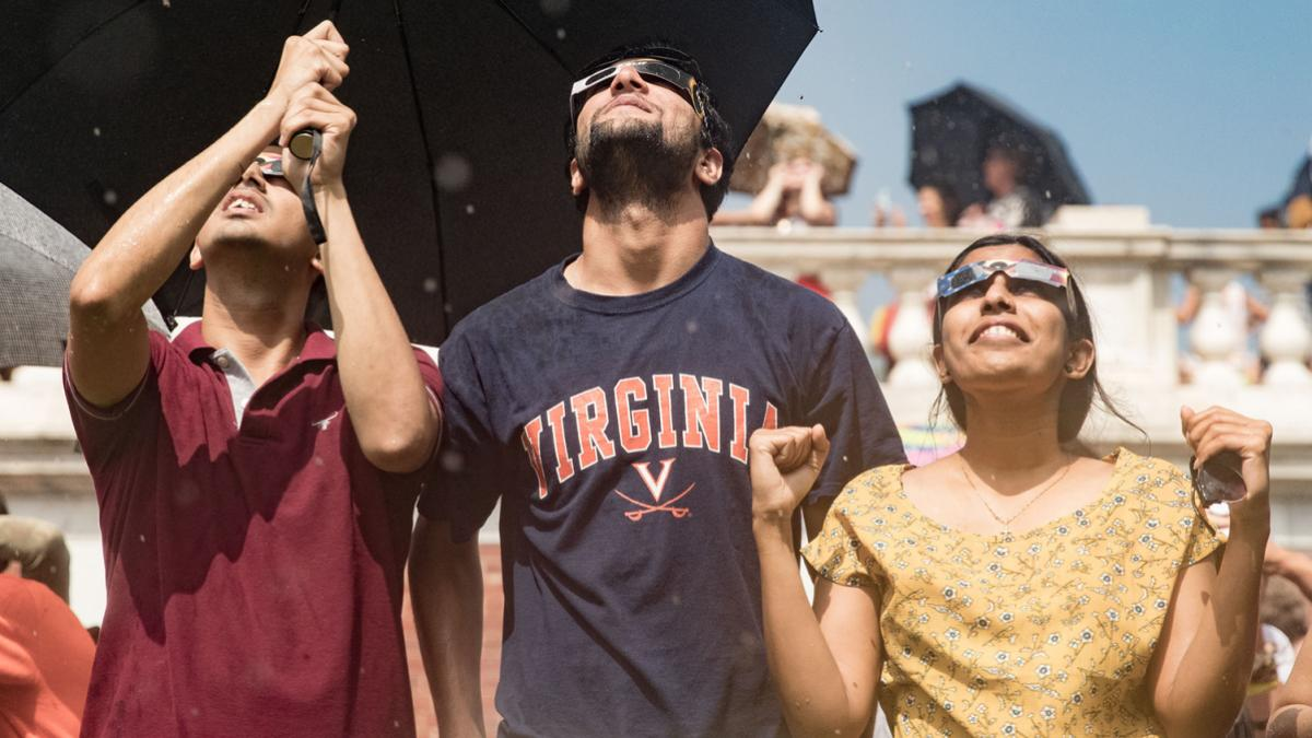 As the storm clouds leave, students catch a few glimpses of the eclipse. (Photo by Sanjay Suchak, University Communications)