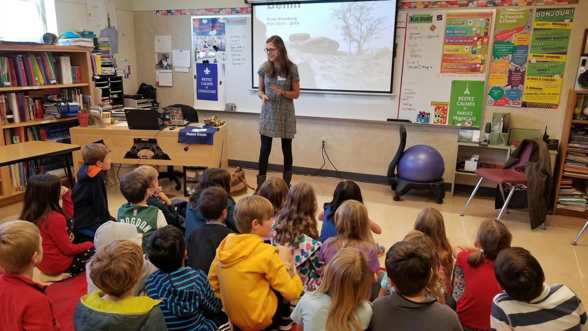 Peace Corps volunteer and 2017 UVA graduate Evan Steinberg talks with students at Charlottesville's Peabody School about her time in Benin. (Contributed photo)