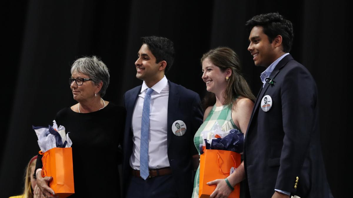 Nikhith Kalkunte, second from left, presented the Algernon Sydney Sullivan awards to Jane Miller, left, Jordan Arnold, and the late Rehan Baddeliyanage, accepted by his brother Roshan Baddeliyanage. (Photos by Sanjay Suchak and Dan Addison, University Com