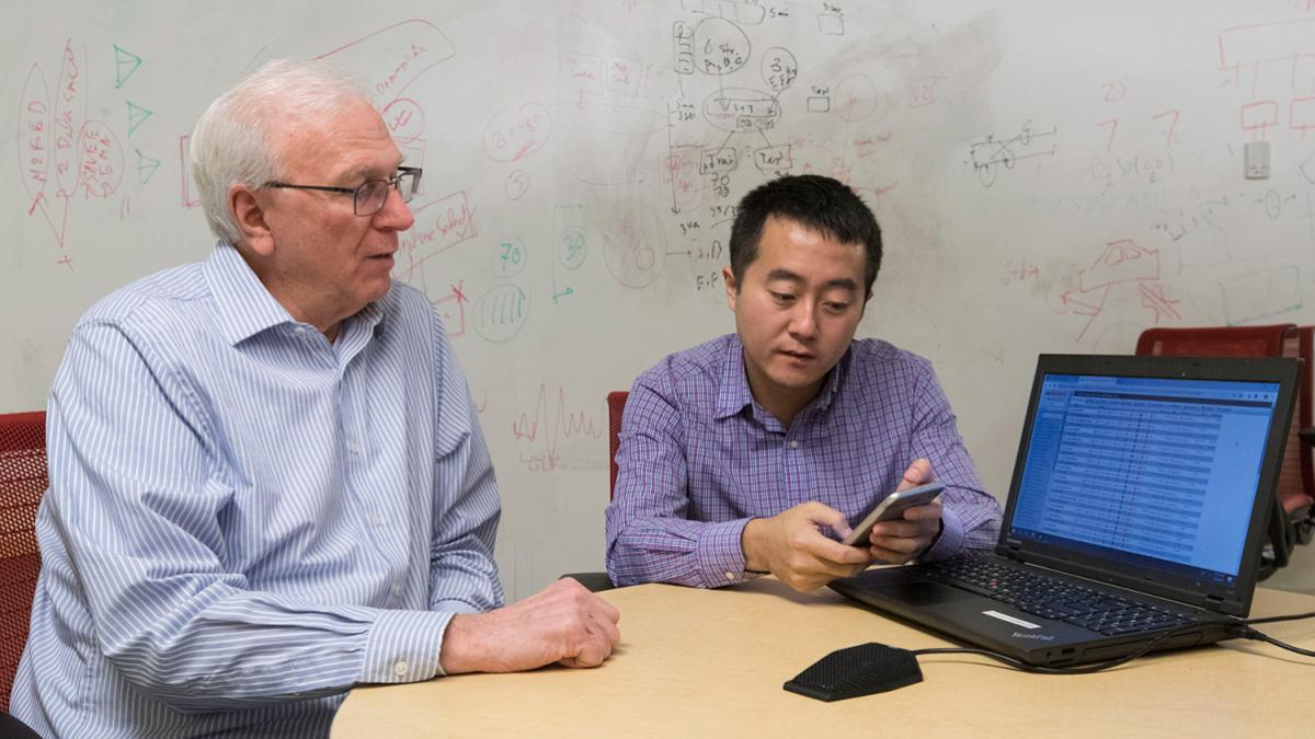 Computer scientists Jack Stankovic, left, and Hongning Wang are developing the system.