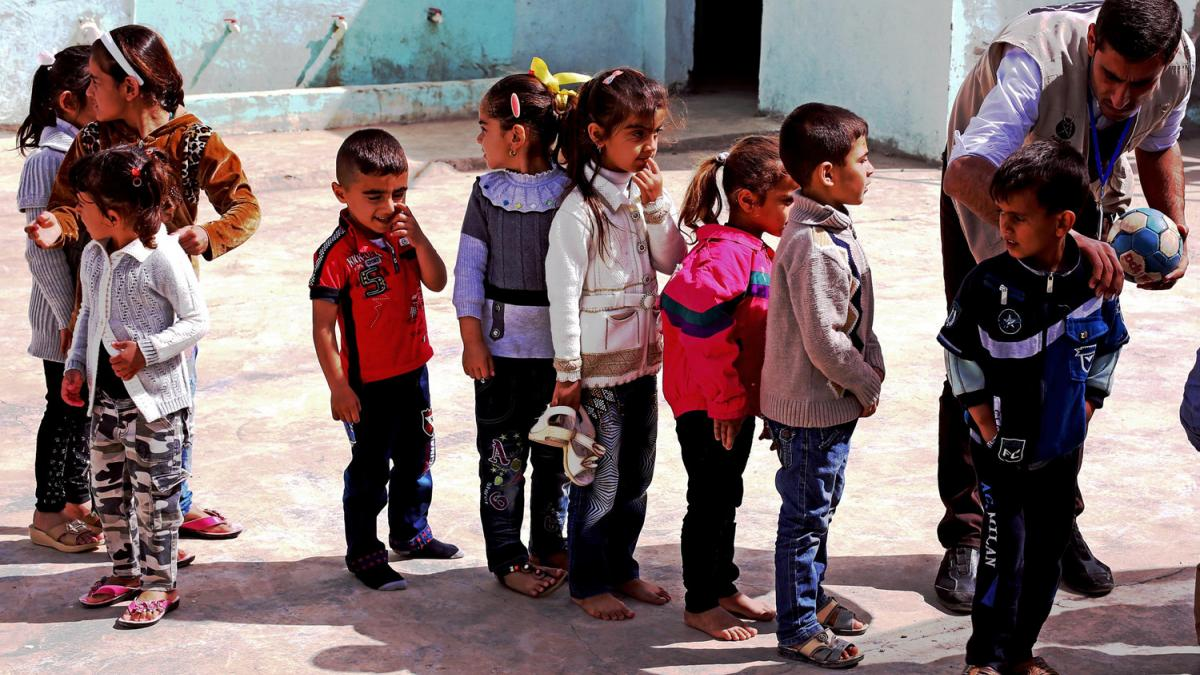 Refugee children assemble at a camp in Iraqi Kurdistan. (Photo by Josh Zakary, Creative Commons)