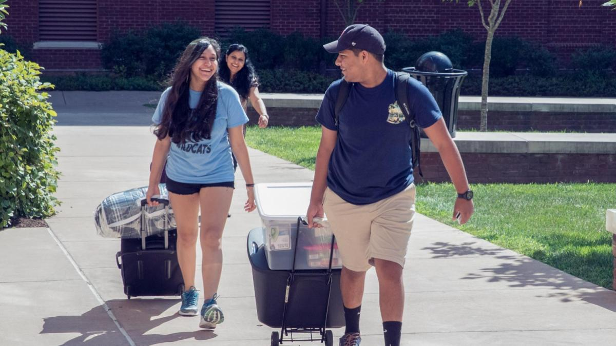 A student gets help moving in last August.