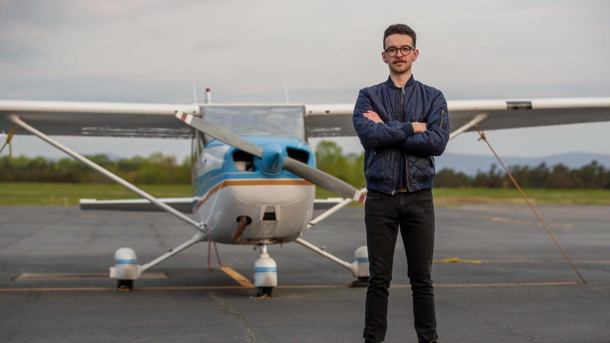 Though Sidney St. Clair found in nursing a career that satisfied his passion for hard science and his love of human connections, he still finds to time to fly as an escape. (Photo by Sanjay Suchak, University Communications)