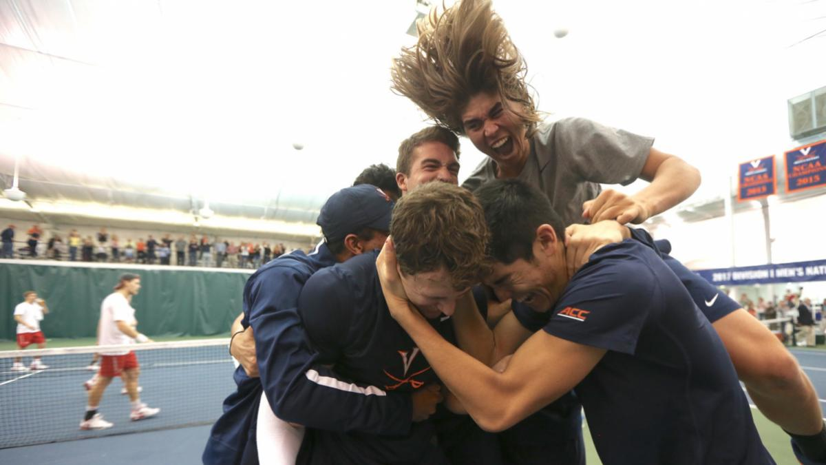 The Cavaliers celebrate their sixth national indoor championship moments after fourth-year J.C. Aragone's tiebreaker victory clinched the match. (Photo by Matt Riley, UVA Athletics)