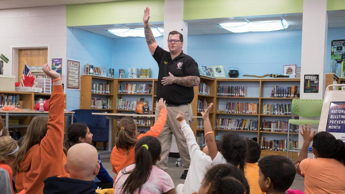 Tyler Dean presents an anti-bullying message to students at the Paul H. Cale Elementary School in Albemarle County.