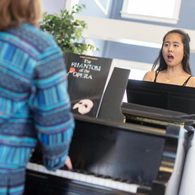 Marcha Kiatrungrit prepares for a singing recital. Sound is a common thread that runs through many of her University of Virginia experiences.