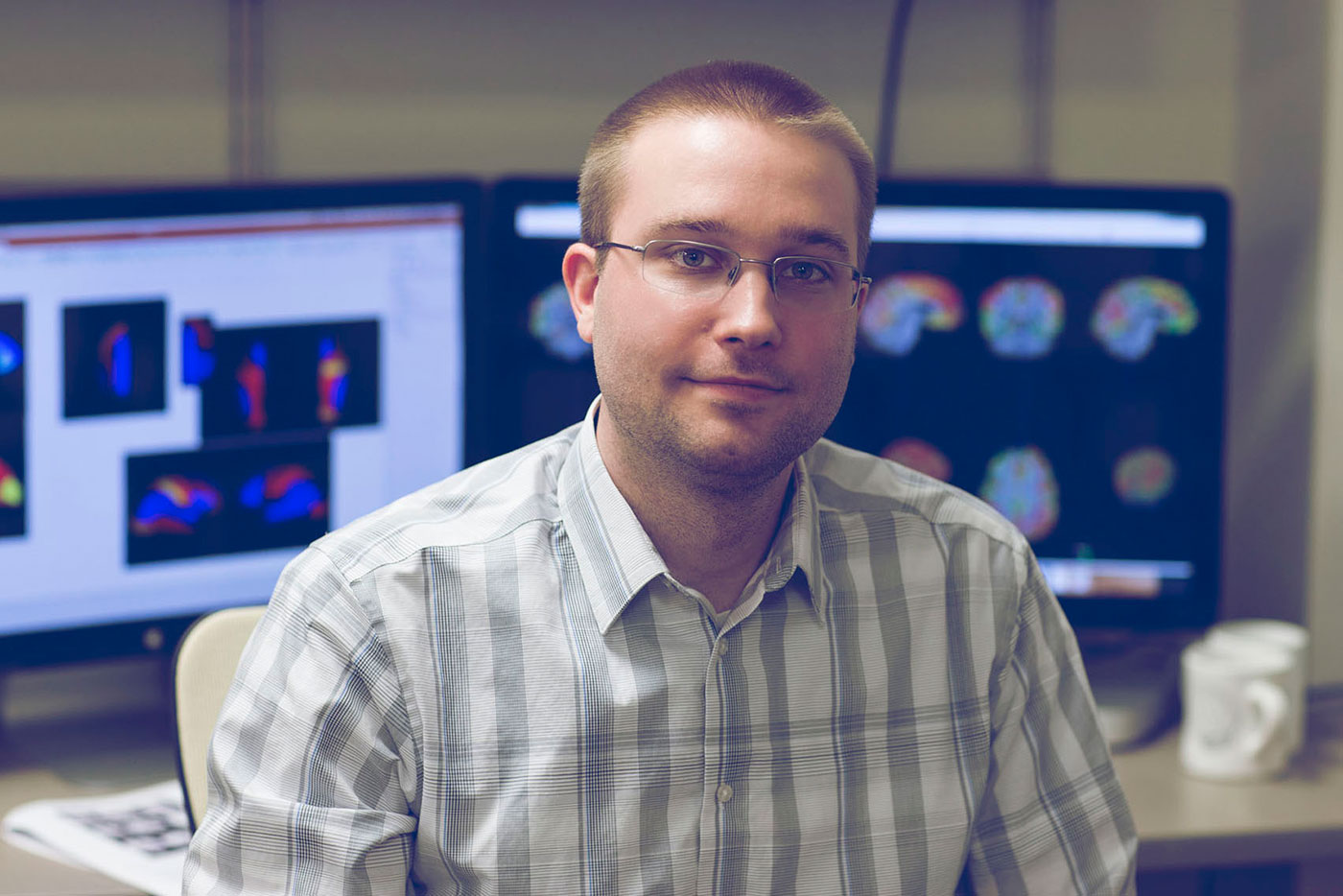 Using fMRI, neuroscience graduate student Bryson Reynolds is studying subconcussions experienced by college football players.