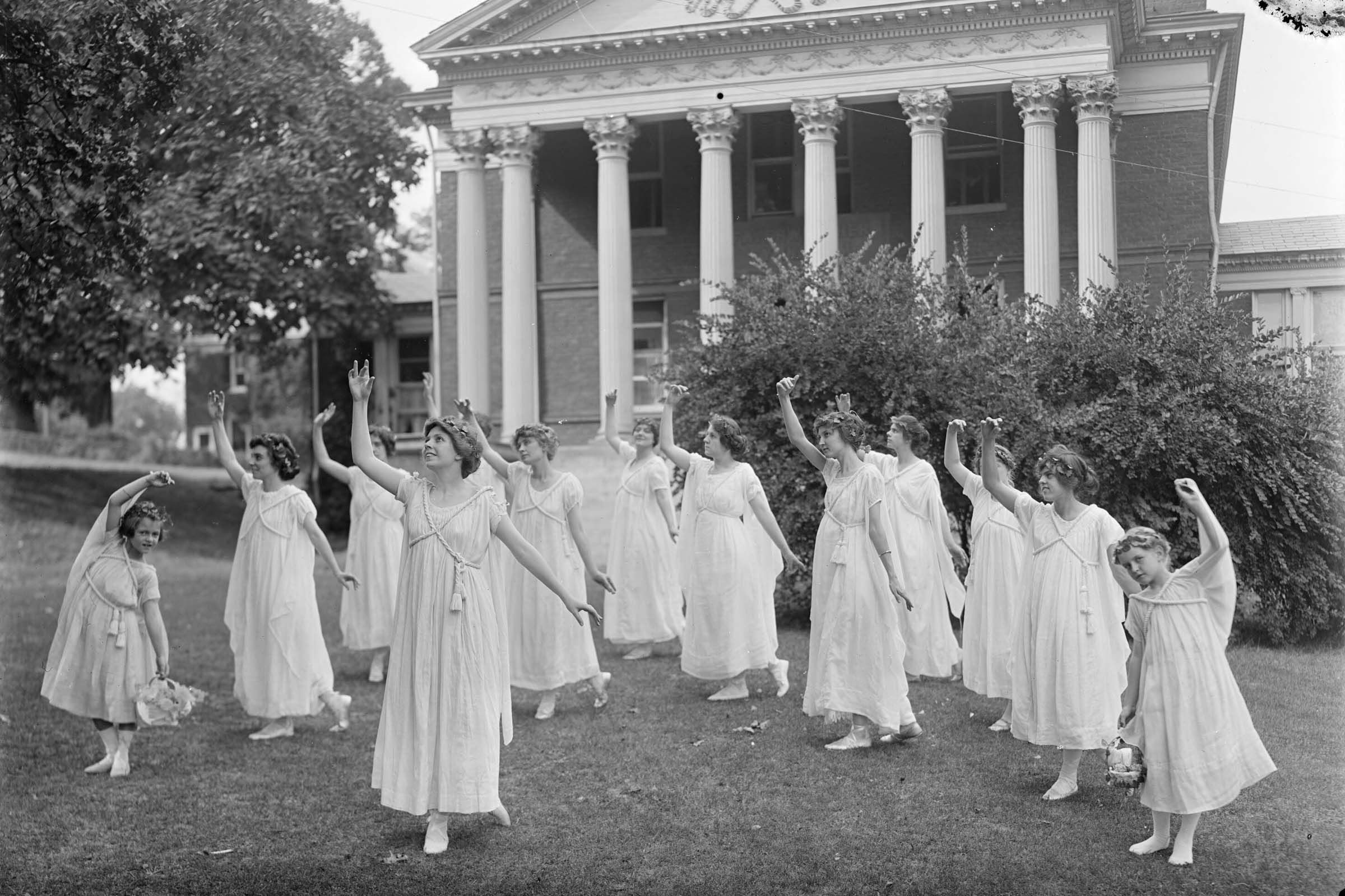 Female students at a themed dance outside Fayerweather Hall in the summer of 1914.
