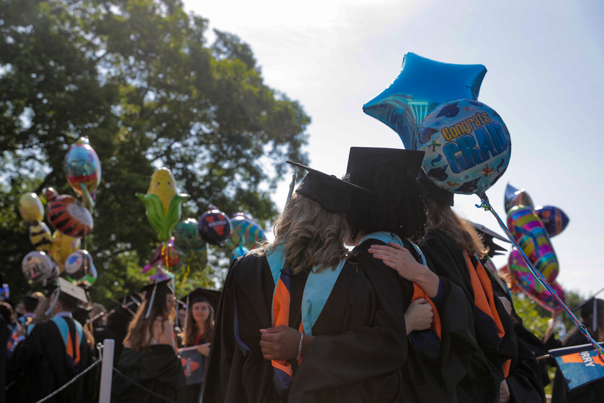 Students rejoice at this year's graduation. (Photo by Sanjay Suchak, University Communications)