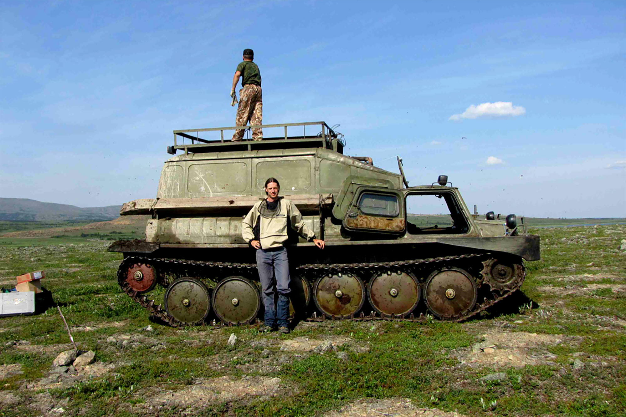 Researcher Gerald Frost stands before an old Russian armored vehicle he and Epstein used to study remote areas of Arctic tundra.