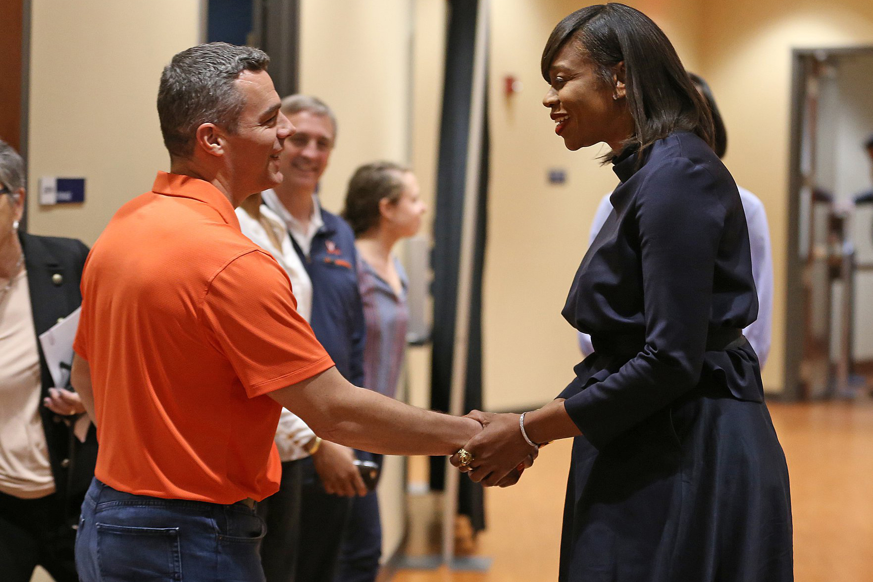 Tina Thompson greeted men's basketball head coach Tony Bennett on Wednesday.