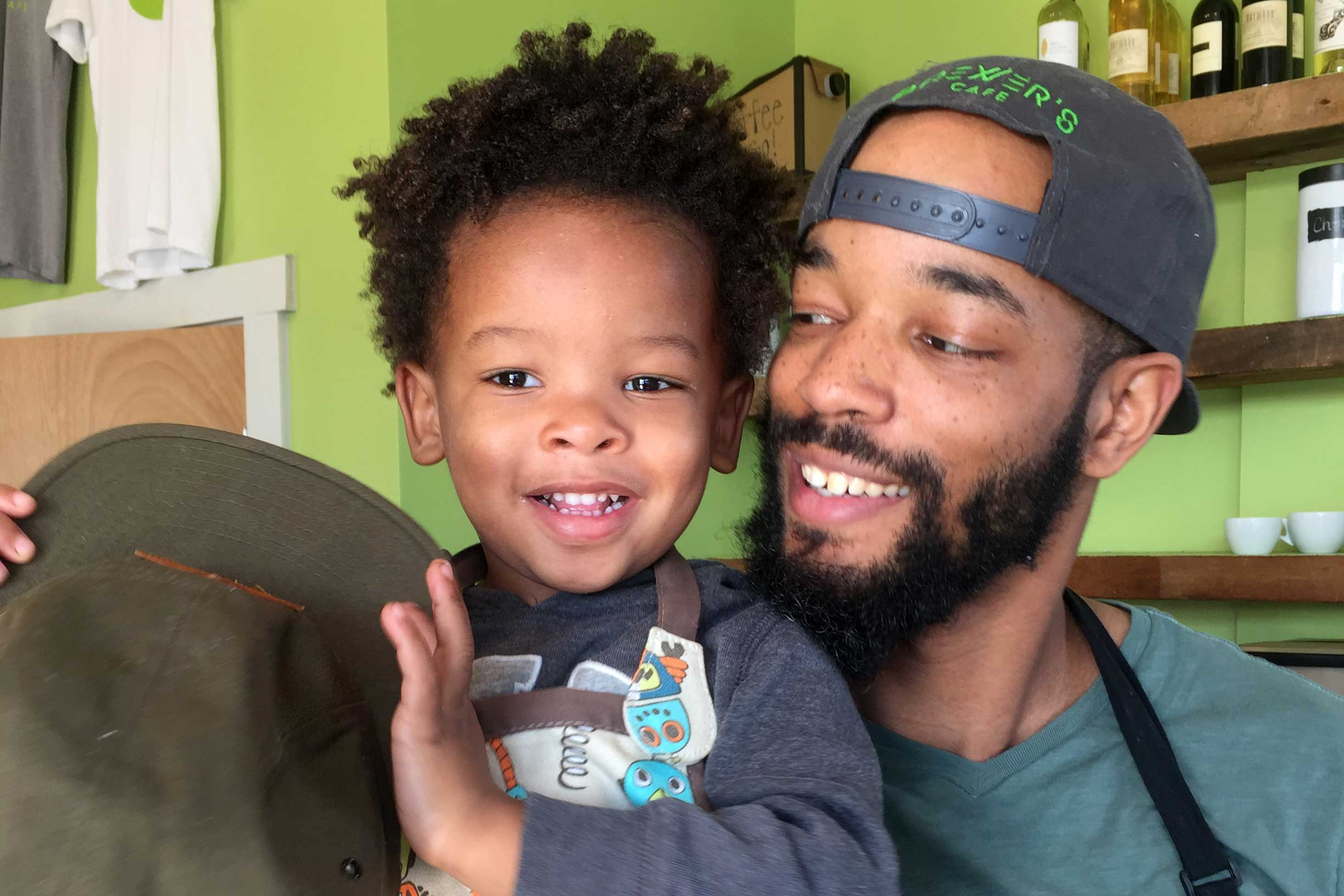 Richmond native A.J. Brewer, pictured here with his 3-year-old son Parker, opened Brewer's Café in 2015. (Photo courtesy of A.J. Brewer.)