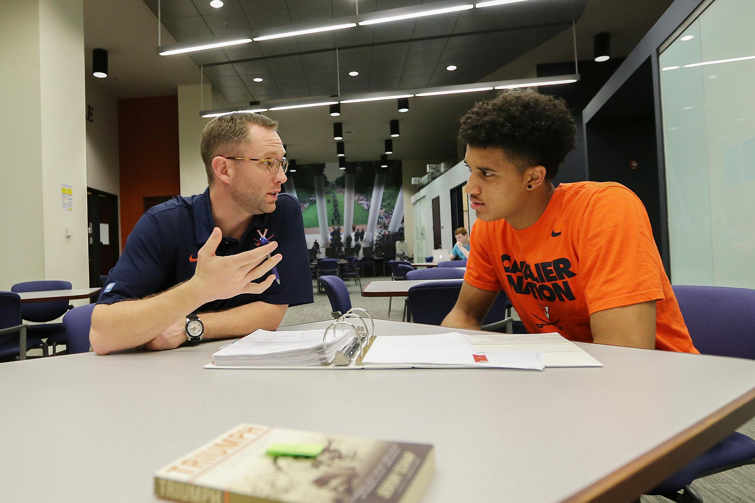 Grams talks with former player Isaiah Wilkins. Grams said Wilkins helped set the standard off the court that the current team follows.