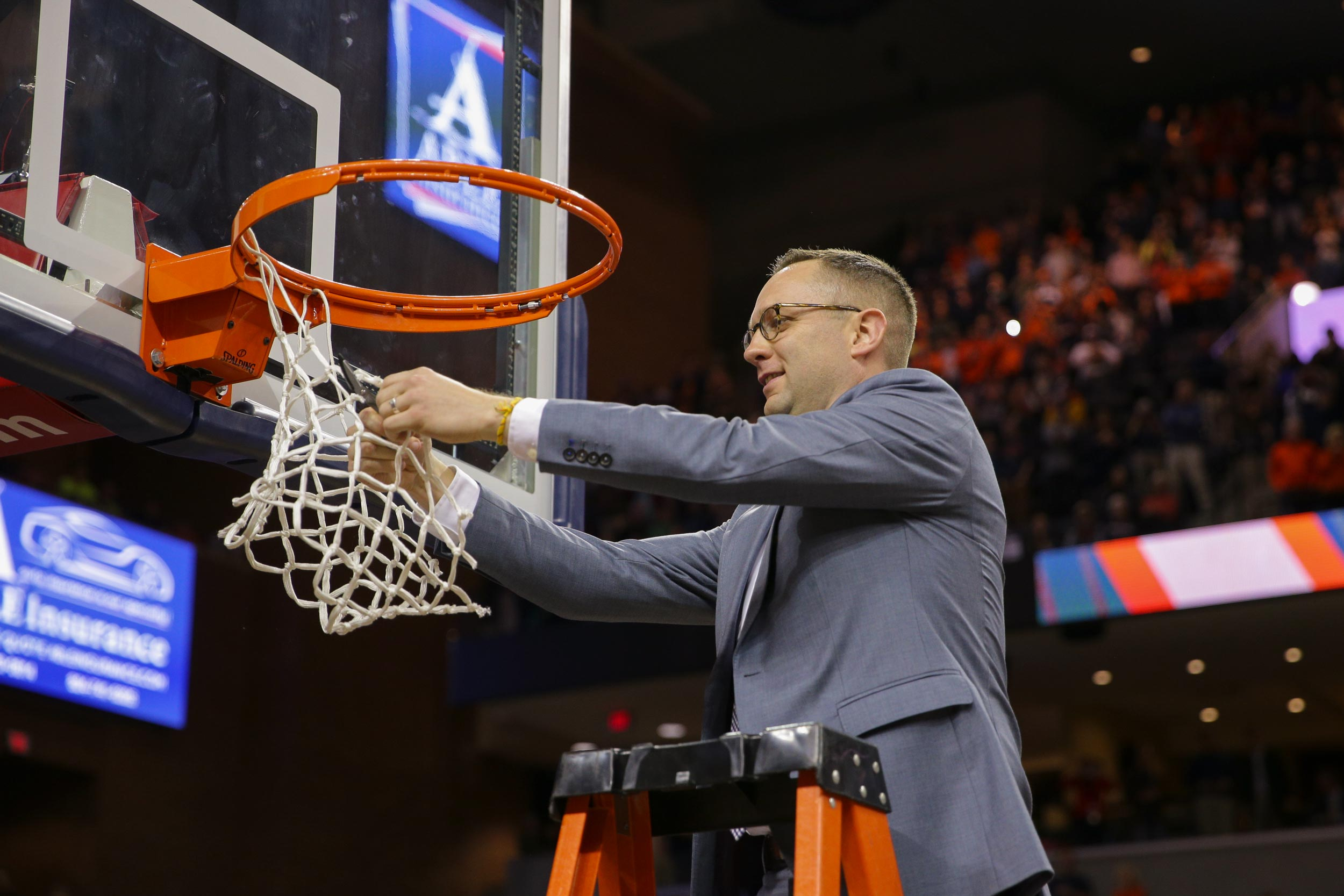 UVA head coach Tony Bennett makes a point to integrate Grams into all areas of the team experience – including cutting down the nets after the 'Hoos captured the ACC regular-season championship.