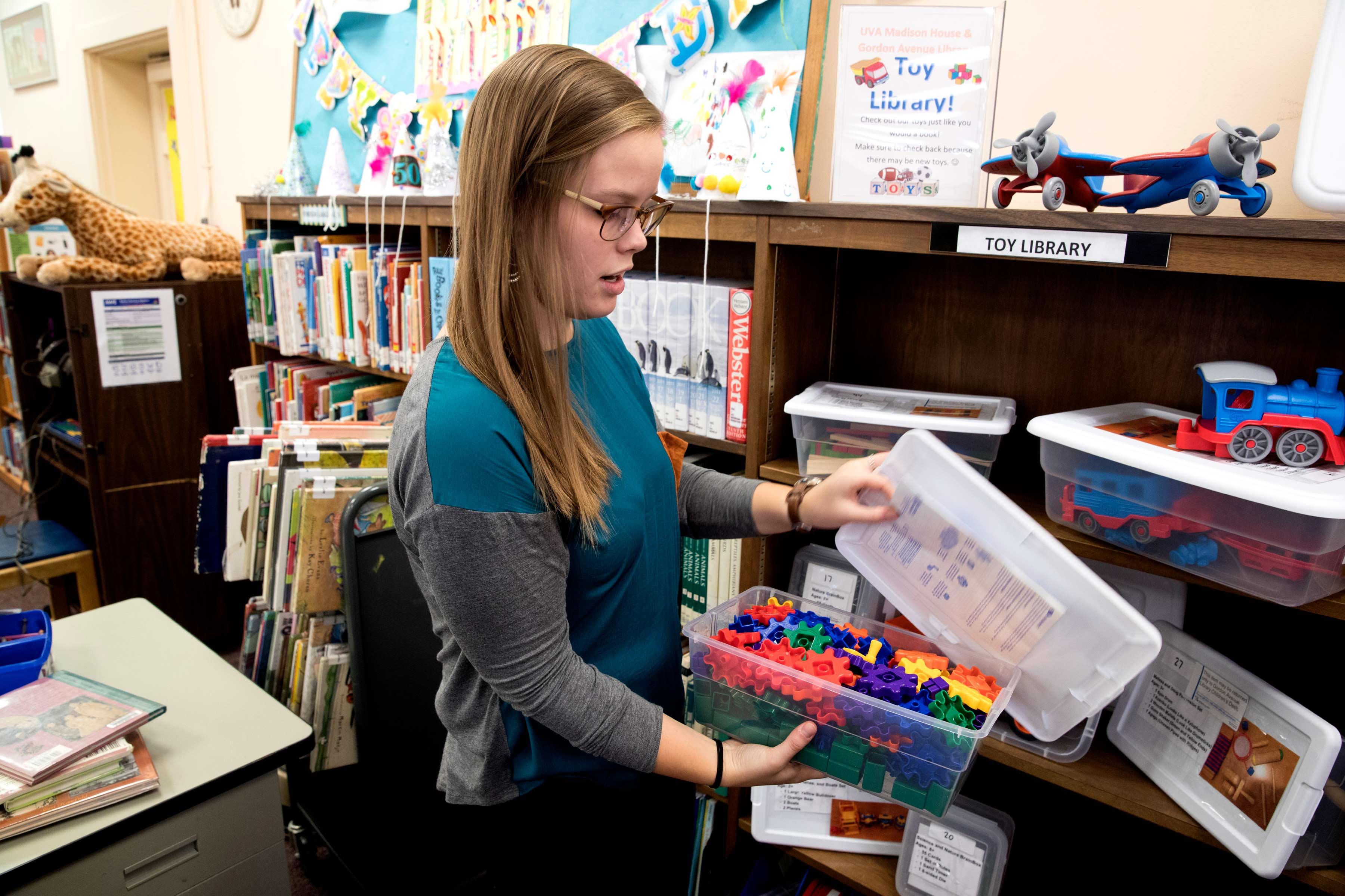 UVA student and program director Madison Lewis shows off the toy library.