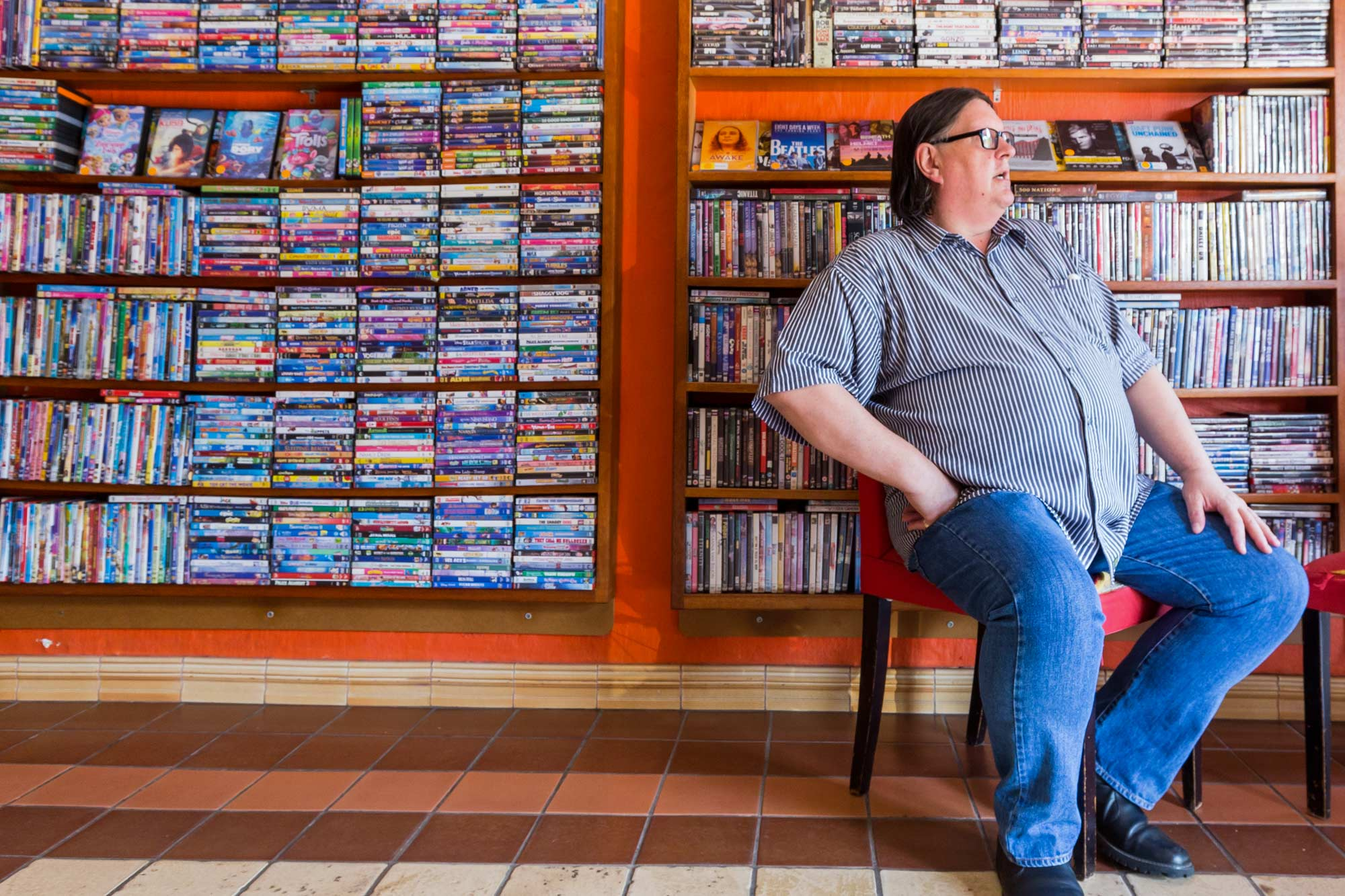Mason captured this photo in The Majestic, a video store near her house in Johannesburg. Henni Erasmus, pictured, helps customers find the movie they are looking for and discover new films. (Photo by Heather Mason)