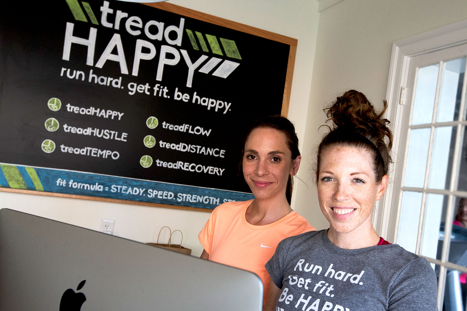 Claire Mitchell and Sara Yeatman Currier, both UVA Curry School of Education alumnae, opened their treadmill-based fitness studio, tread HAPPY, in February.