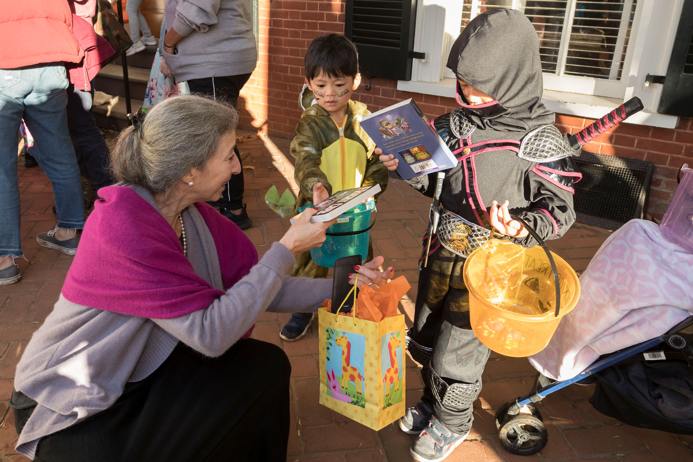 Jeanna Beker founded The Soho Center 48 years ago in New York. She brought it to Madison County 30 years ago when she and her family relocated to Central Virginia. She gave out free books at this year's Trick or Treating on the Lawn.