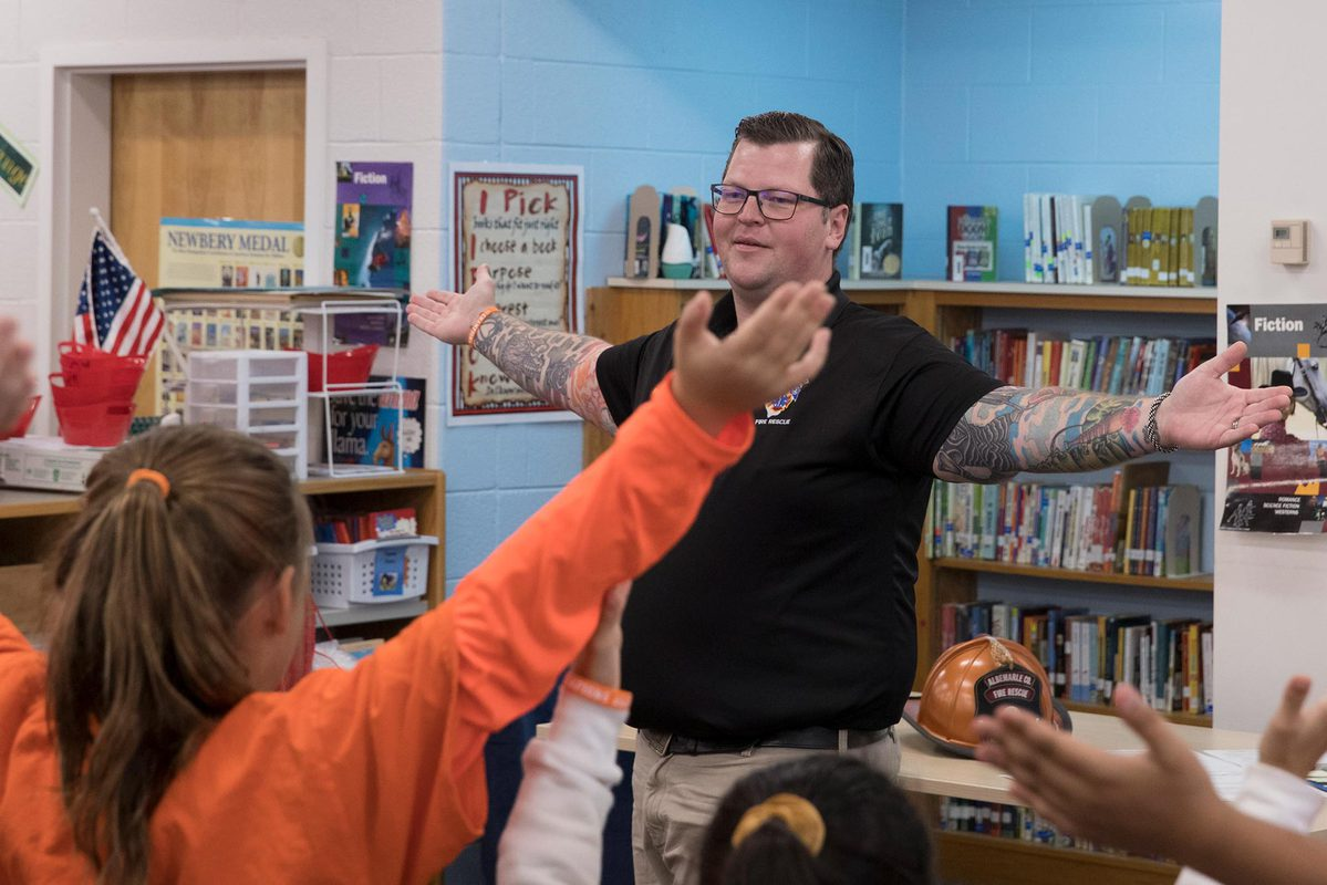 SCSP student Tyler Dean leads students in a warm-up before his anti-bullying talk at Paul H. Cale Elementary School.