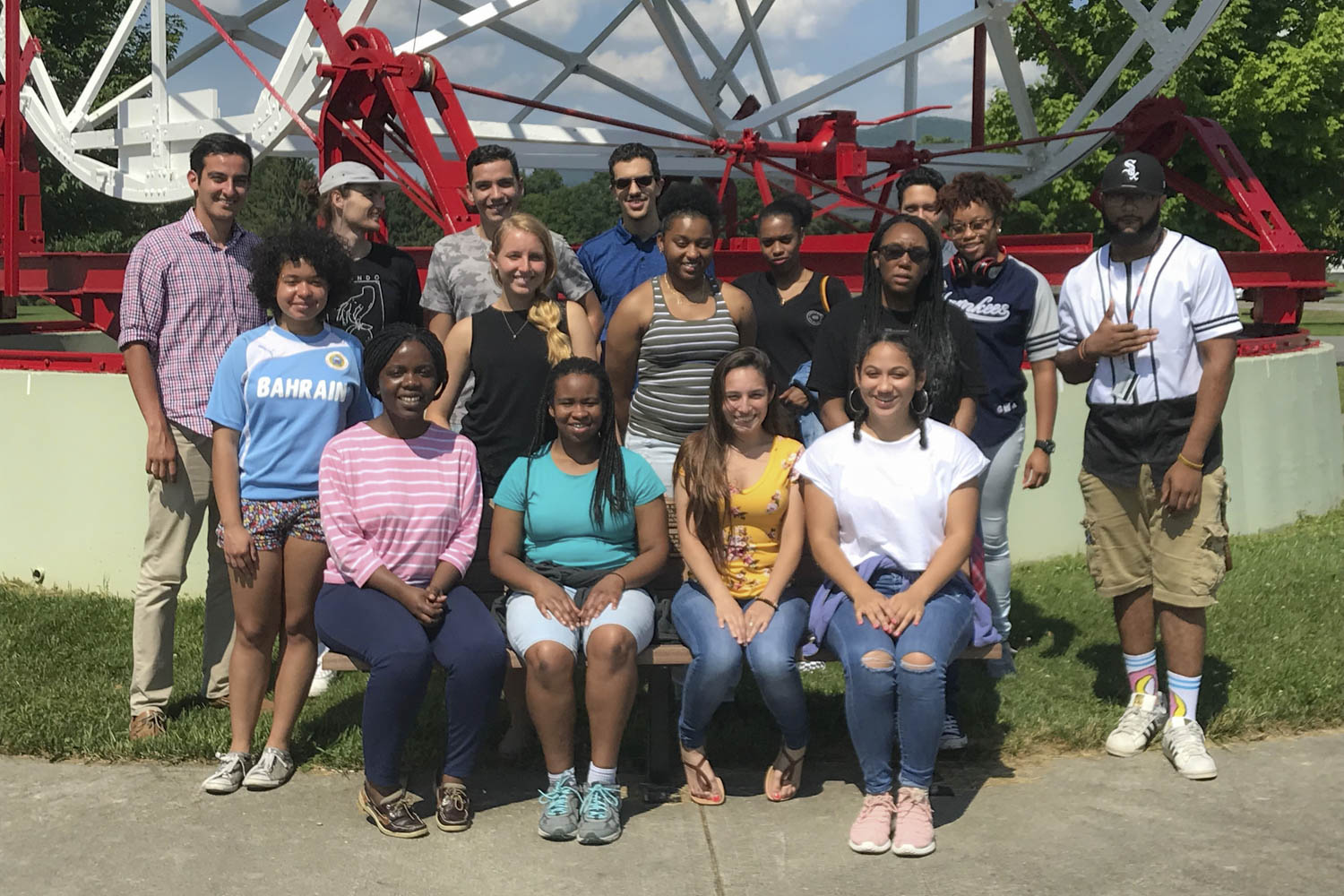 Students in the Virginia-North Carolina Alliance program pose for a photo in front of the Reber Telescope at the Green Bank Observatory in Green Bank, West Virginia.