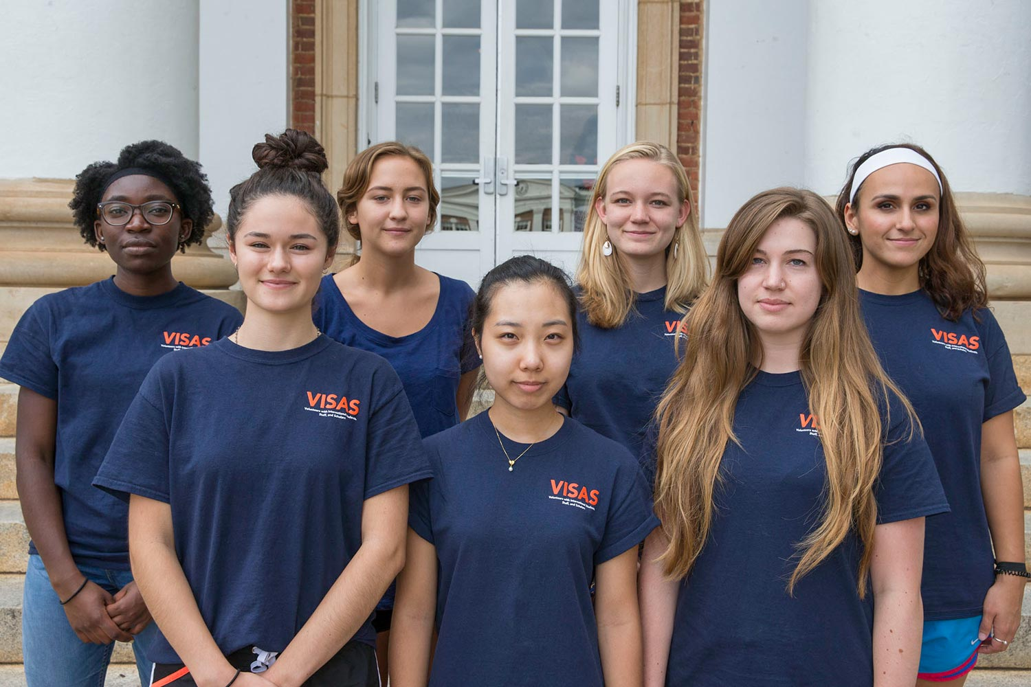 VISAS student volunteers back row from left to right: Elma Adusei, Elise McMath, Carolyn Ours, Gabriela Mendoza. Front row from left to right: Isabelle Burke, Jessie Jung, and Emily Hayes. (Photo by Dan Addison, University Communications)