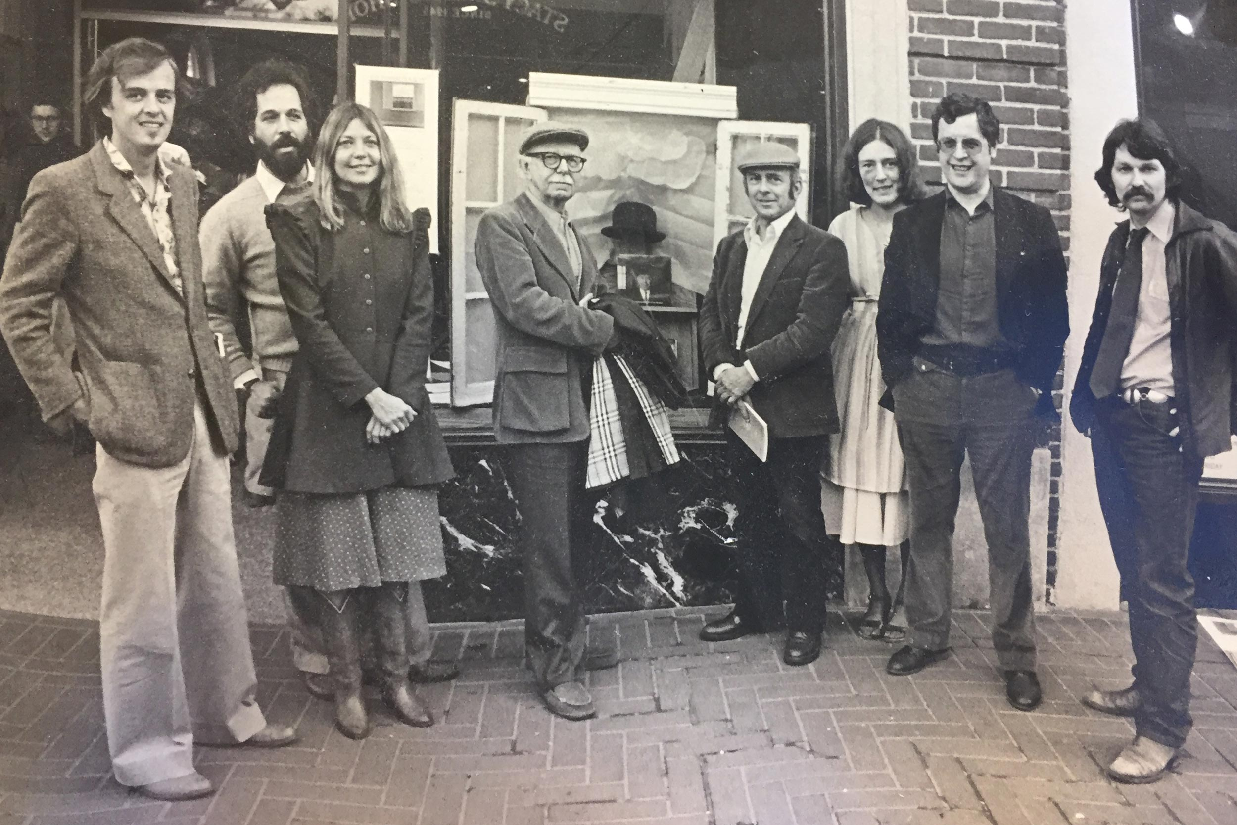 A UVA conference on surrealism in 1978 with poets (from left) James Tate, Ira Sadoff, Carol Muske, David Ignatow, Louis Simpson, McKeel McBride, Charles Simic and Greg Orr, at the old Williams Corner Bookstore on the Downtown Mall.