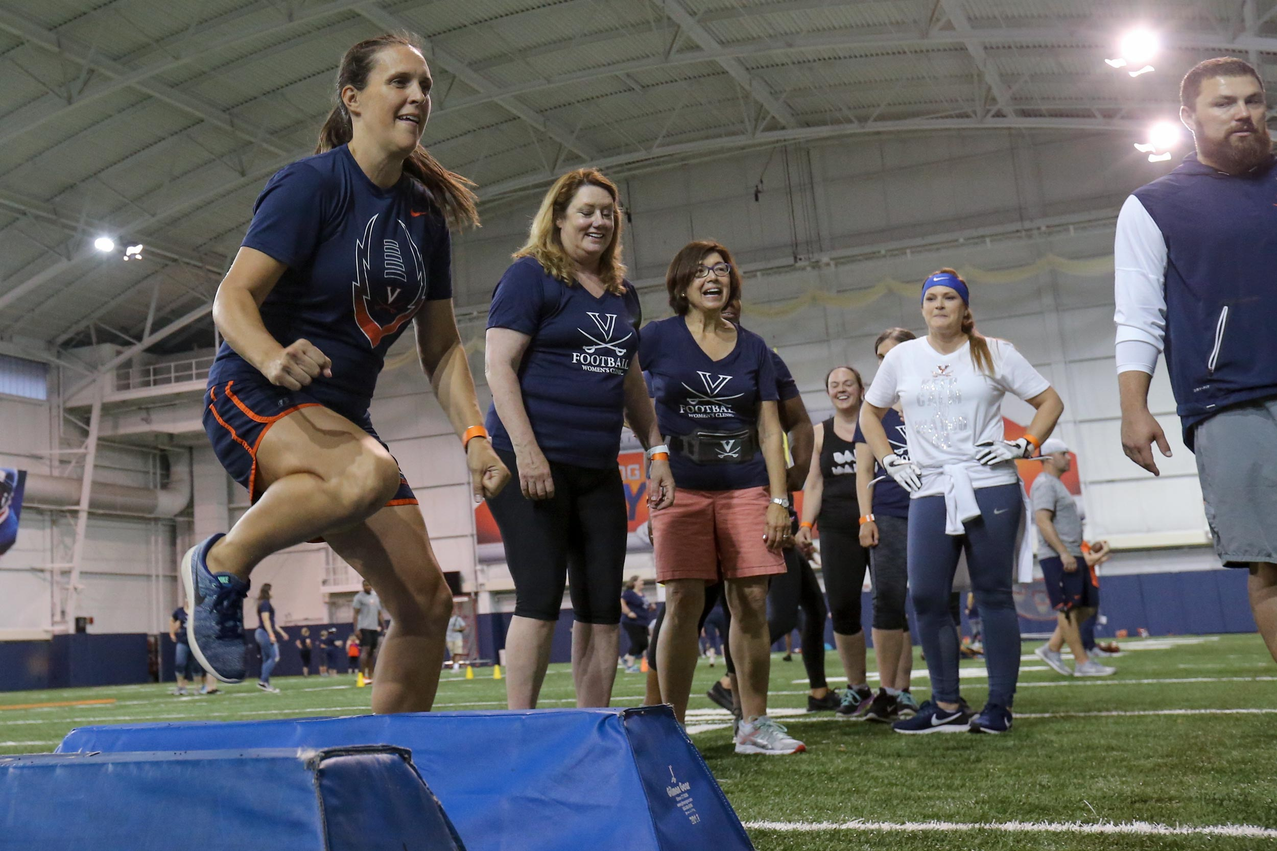 The football coaching staff promised that the clinic would be participatory, and they put the players through many of the same drills that the Cavaliers endure during practices.