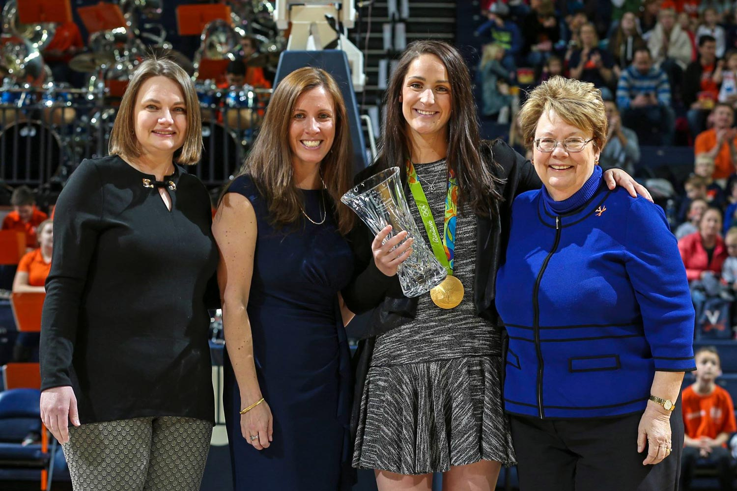 Gold medalist Leah Smith, center, was honored at the National Girls and Women in Sports event in February, with, from left, Women's Center Director Abigail Palko, Valerie Richardson of Athletics and UVA President Teresa A. Sullivan. (Photo by Matt Riley)