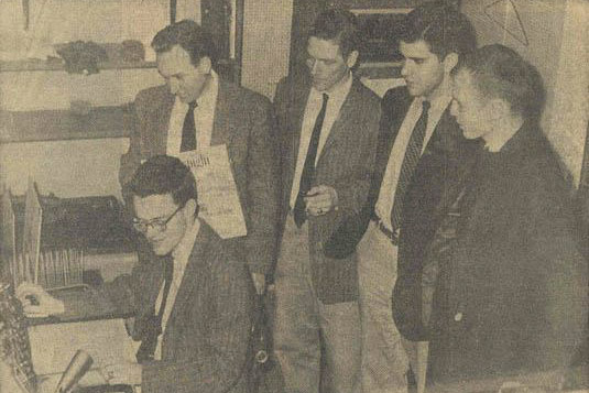 A newspaper clipping showing student broadcasters hard at work on an exam-time marathon of classical music, one of the most popular program offerings in the first years of WTJU.