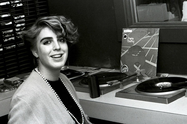 Student Maria Rodriguez spinning records in 1985.
