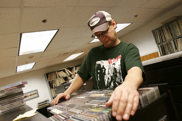 Community DJ Robin Tomlin selects a record from WTJU's extensive archives. Many community volunteers join students in the studio.