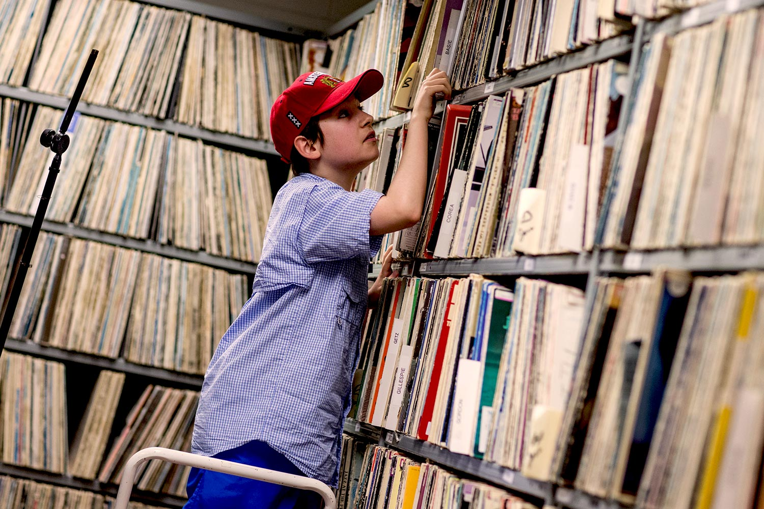Camper Kieran Garrod searches for a record in WTJU's extensive library of vinyl records.