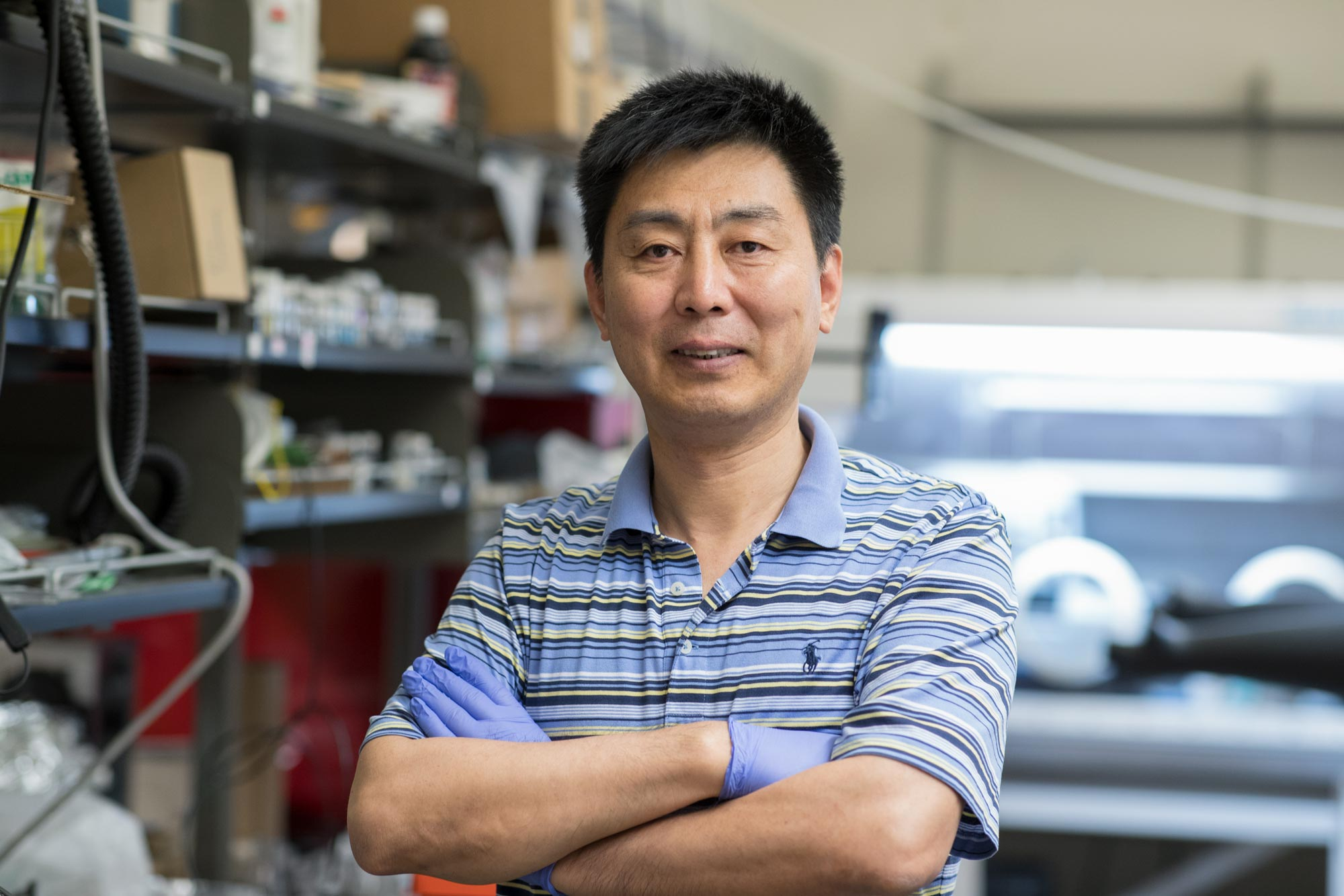 """Xiaodong """"Chris"""" Li, a UVA professor of mechanical and aerospace engineering, is creating sensors that give 3-D printers a human-like ability to """"make real-time decisions"""" to create flawless products. (Photo by Dan Addison, University Communications)"""