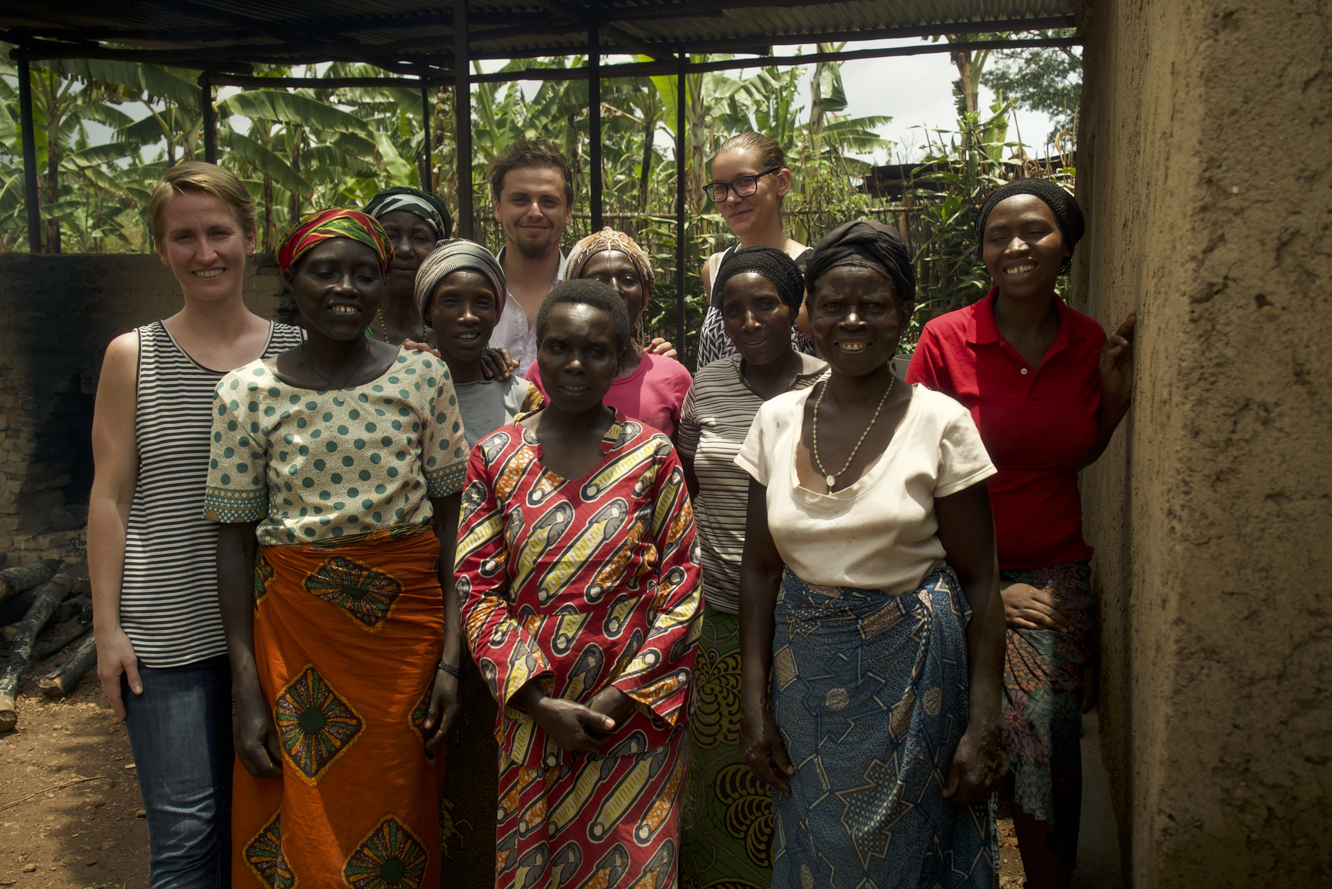 "The ""Zaza Rising"" team, including alumna Elizabeth Dettke (far left), schoolteacher and entrepreneur Christine Nyirahabimana (far right) and several women from the Duterimbere Bakery."